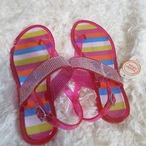 Wonder Nation pink rainbow jelly thong sandals 1/2
